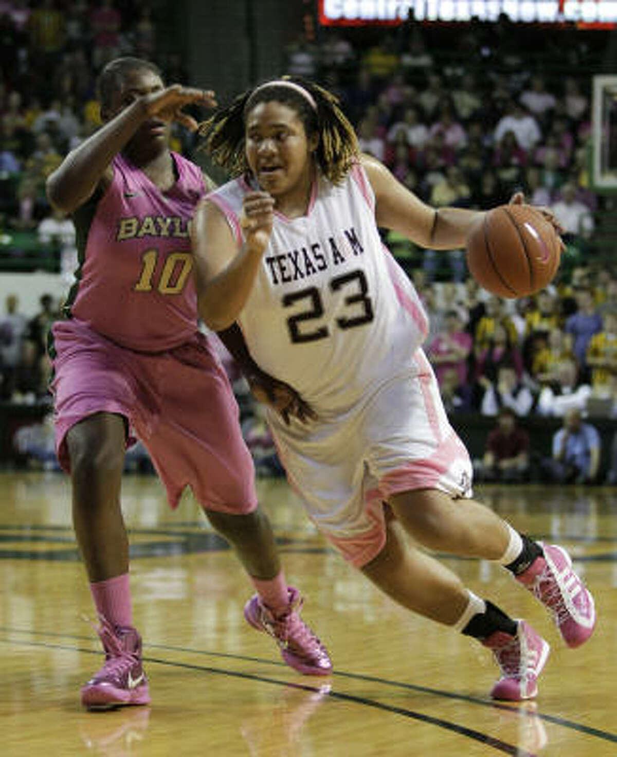 Texas A&M forward Danielle Adams (23) drives past Baylor forward Destiny Williams (10).