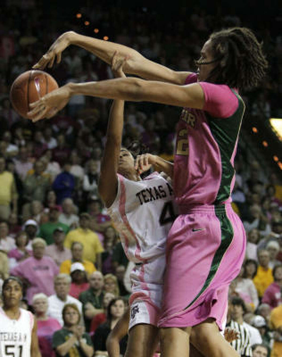 Baylor center Brittney Griner, right, blocks a shot attempt by Texas A&M guard Sydney Carter (4).