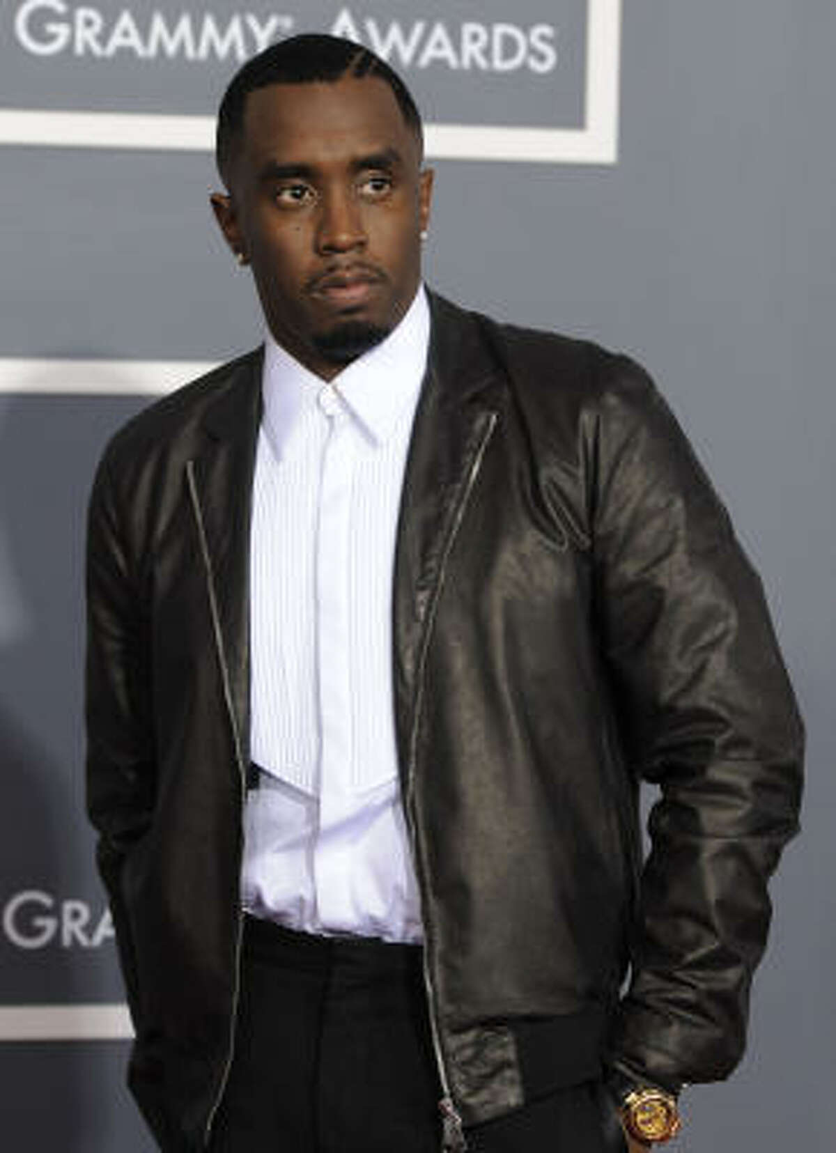 Diddy, in crisp white tux shirt that oddly works with a leather jacket