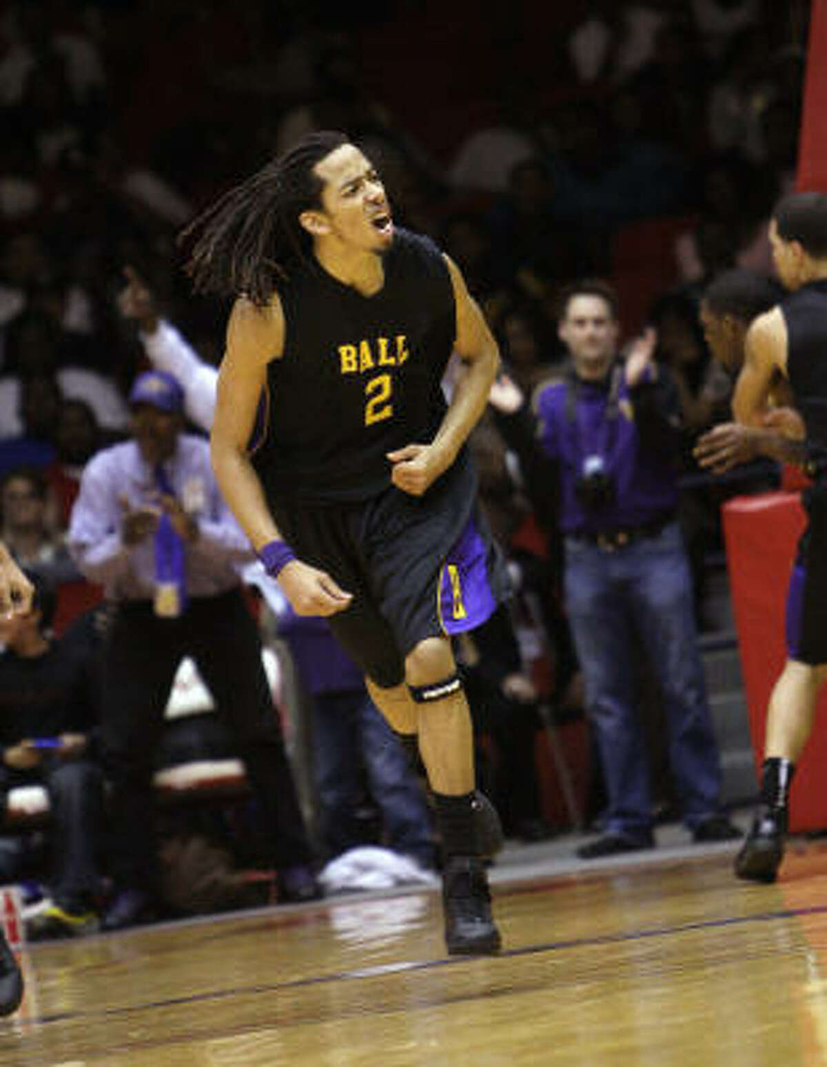 Ball's Terran Petteway celebrates after hitting a shot in the fourth quarter. He finished with 23 points, 12 rebounds and four steals.