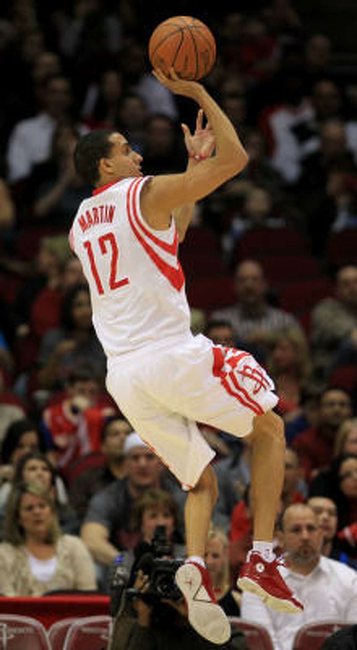 Rockets guard Kevin Martin puts up a soft running shot for a basket in the first quarter. Martin finished with 17 points.