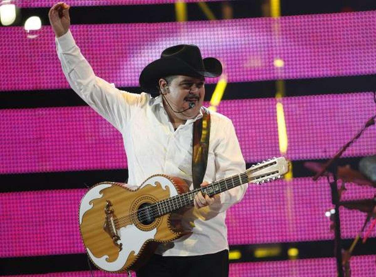 Pepe Elizondo, of Pesado, performs at the Houston Livestock Show and Rodeo at Reliant Stadium.