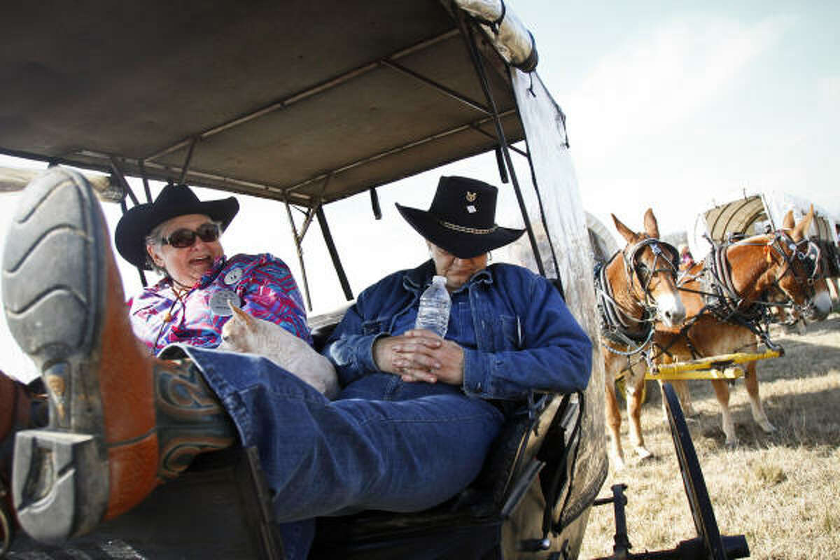Cindi Hester takes a catnap during a short break for the Spanish Trail trailriders near I-45 and Shepherd Dr. as the team of wagons and trailriders make their final push to Memorial Park in Houston.