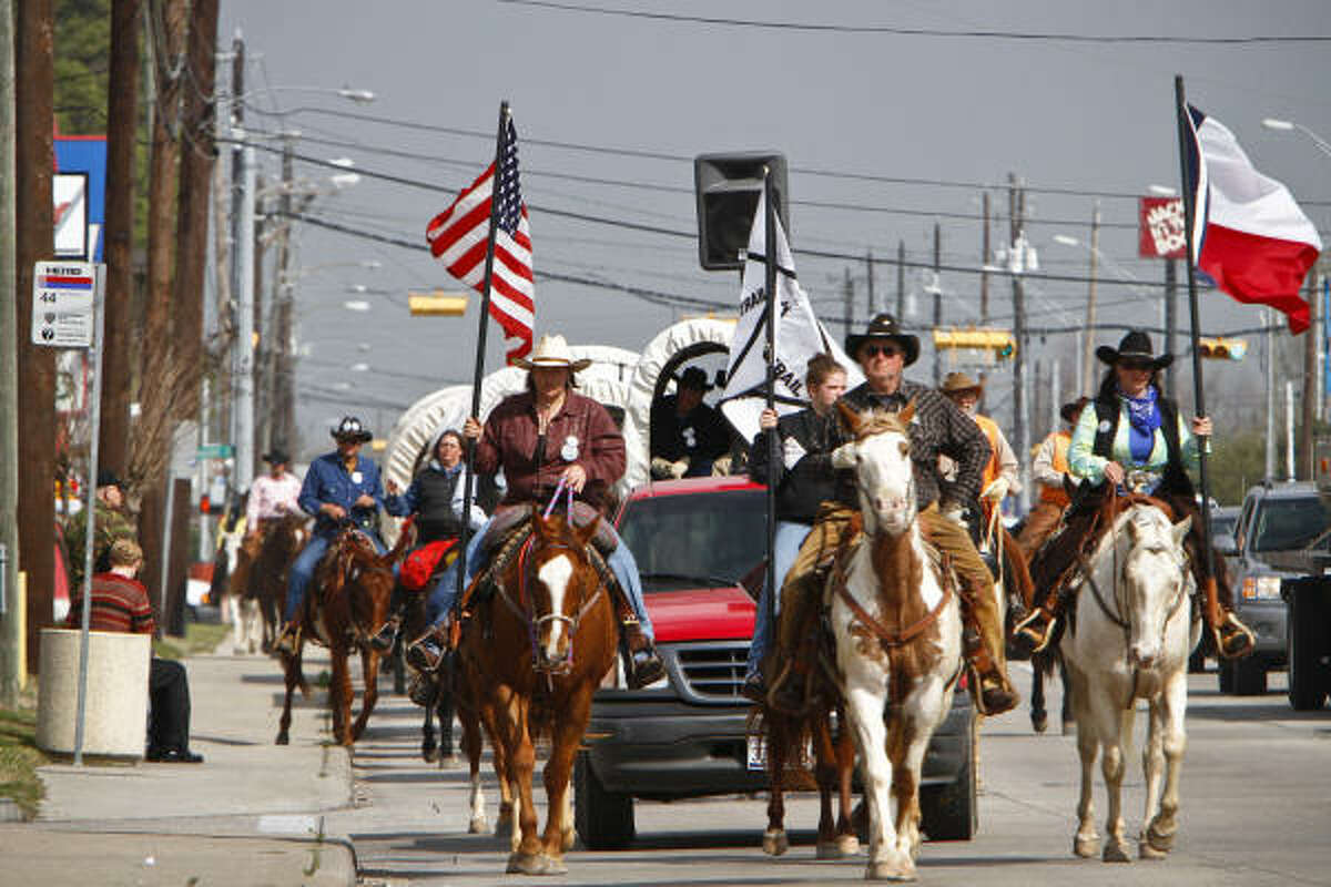 Members of the Spanish Trail trailriders make their way down Shepherd Dr. as they make their final push to Memorial Park.
