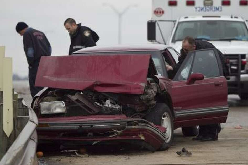 A Harris County Sheriff's Office deputy assists a driver who was in an accident on The Sam Houston Toll Road and Almeda Road Friday, Feb. 4, 2011, in Houston.