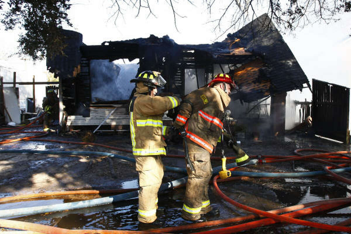 Firefighters work to extinguish a house fire near the intersection of Yale and 15th Streets Tuesday afternoon.