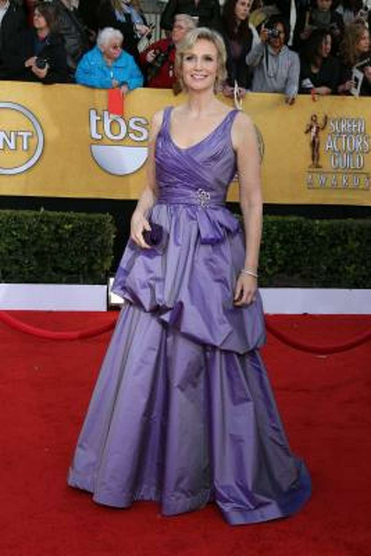 Jane Lynch wearing a purple, poofy mess by a designer we've never heard of.