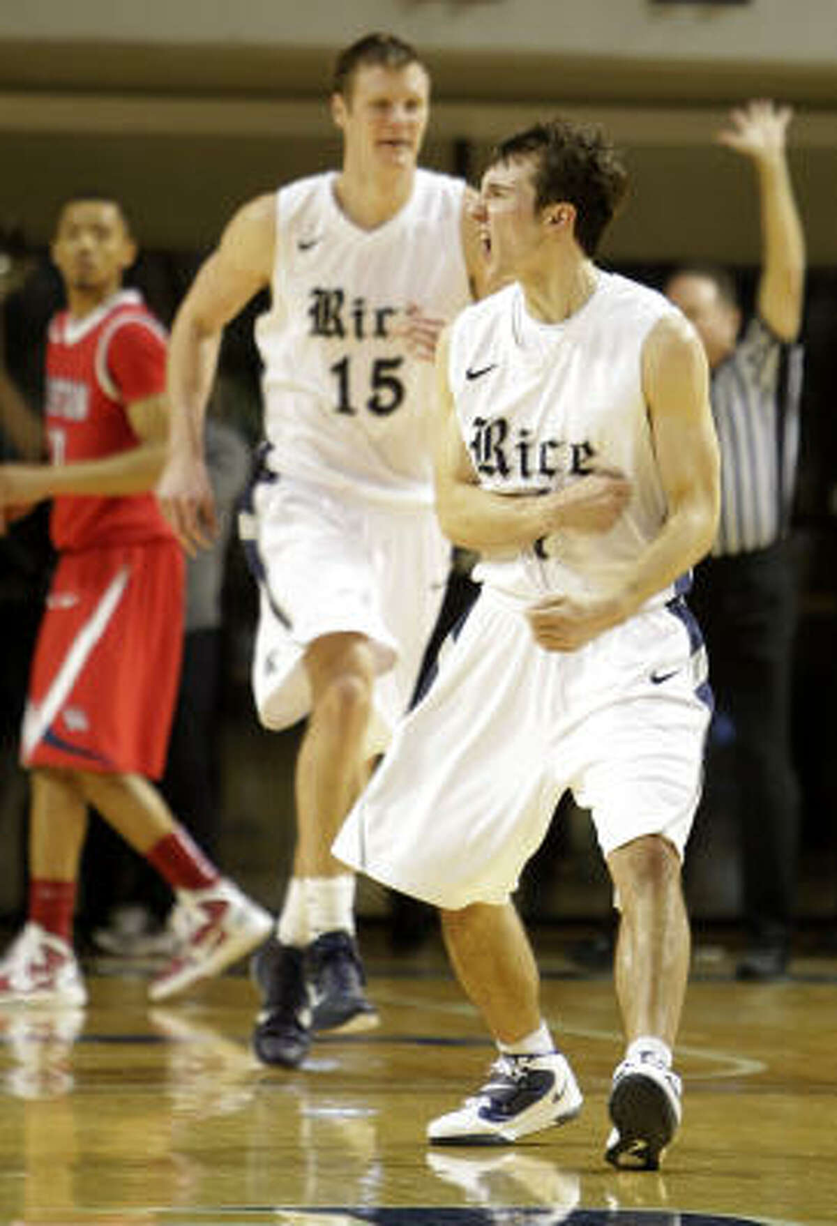 Rice guard Connor Frizzelle (4) celebrates his three-point shot during the second half.