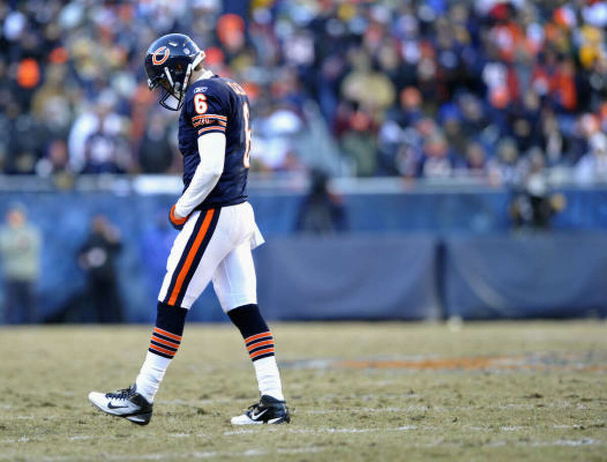 Bears quarterback Jay Cutler trudges off the field after the Bears failed on a third-down attempt.