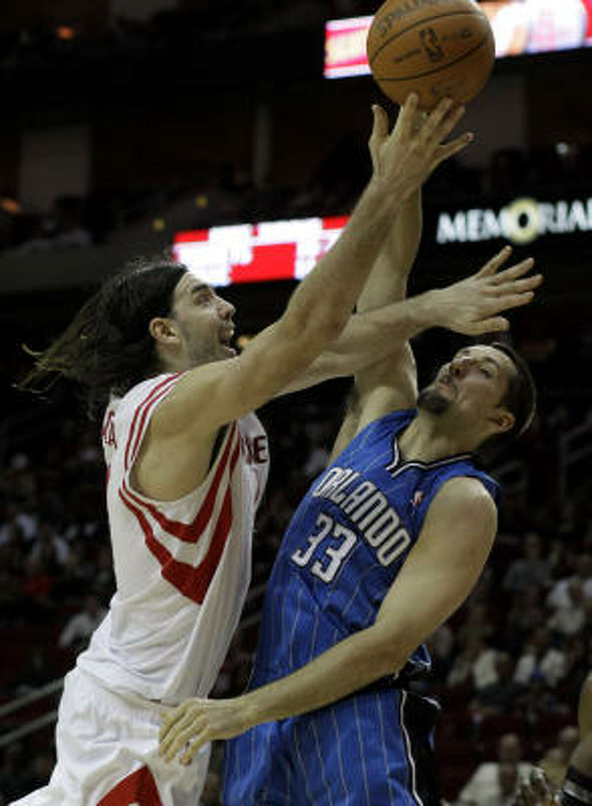 Rockets forward Luis Scola, left, shoots over Orlando's Ryan Anderson during the second half.
