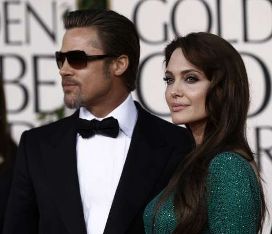 Actors Brad Pitt and Angelina Jolie Photo: Matt Sayles, AP