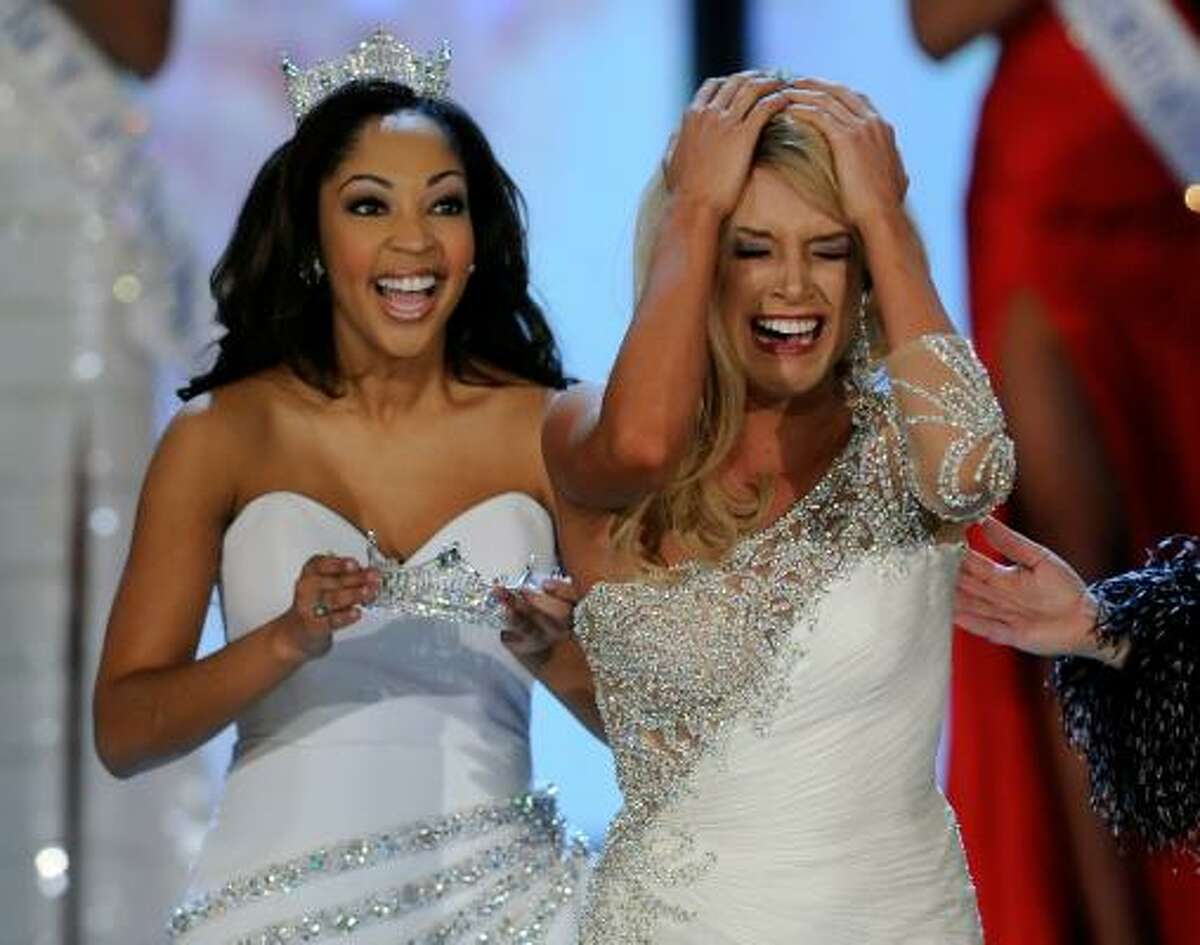 Winner Teresa Scanlan can hardly contain herself. Miss America 2010 Caressa Cameron cheers her on.