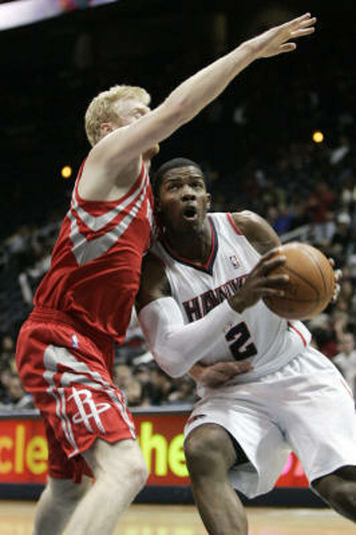 Hawks guard Joe Johnson (2) tries to drive past Rockets forward Chase Budinger. Johnson finished with a game-high 30 points.