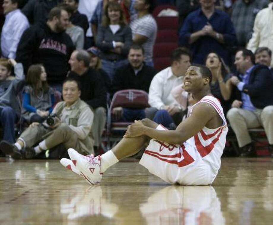 Jan. 14: Hornets 110, Rockets 105 (OT) Rockets guard Kyle Lowry sits on the floor after missing a game-winning shot at the end of regulation of Friday's game at Toyota Center. Lowry led the Rockets with 28 points, but it wasn't enough to keep the Rockets from falling to 0-4 in overtime games this season. Photo: George Bridges, MCT