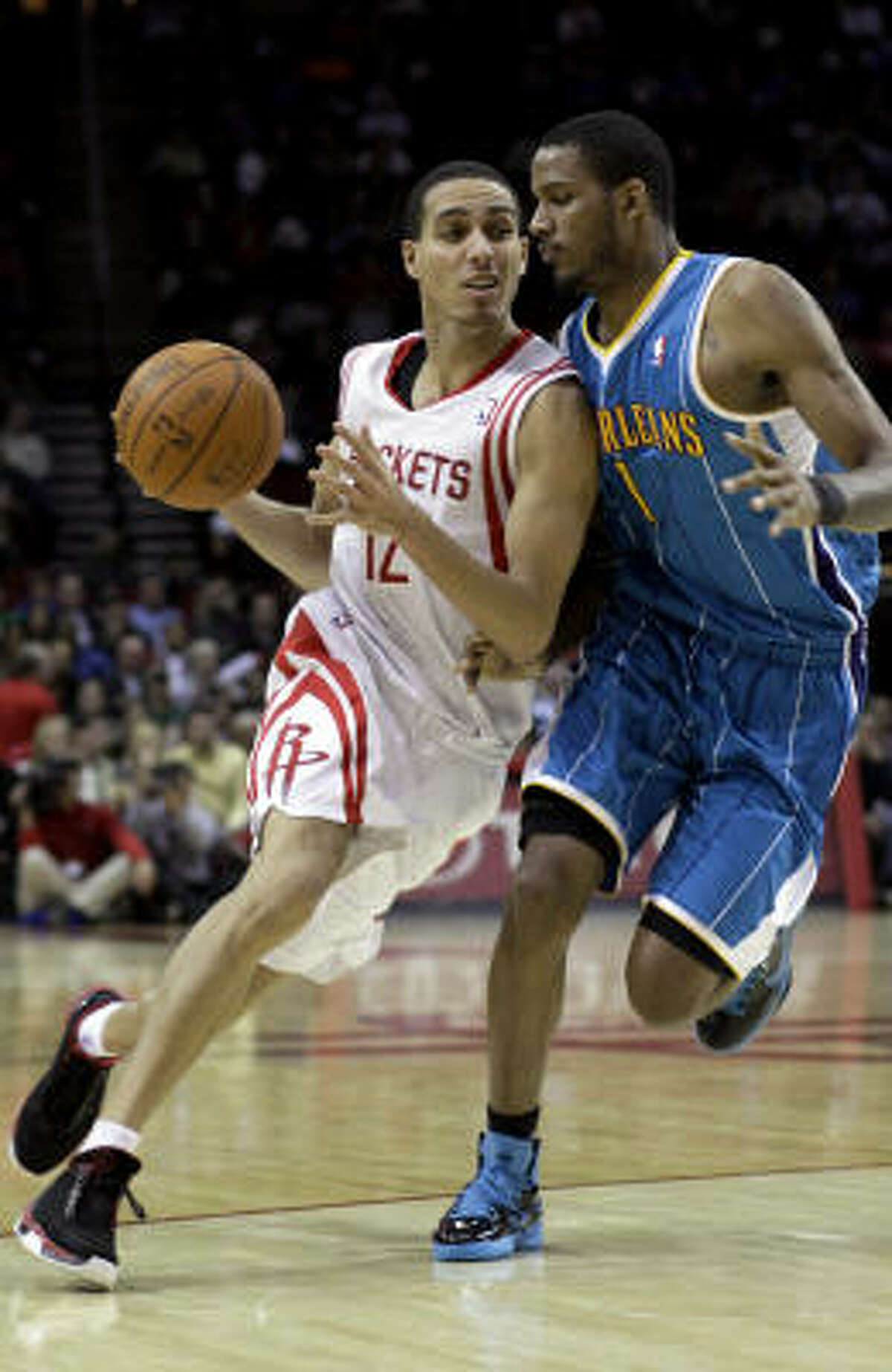 Rockets guard Kevin Martin, left, pushes against New Orleans' Trevor Ariza on his way to the basket in the second half. Martin finished with 26 points.