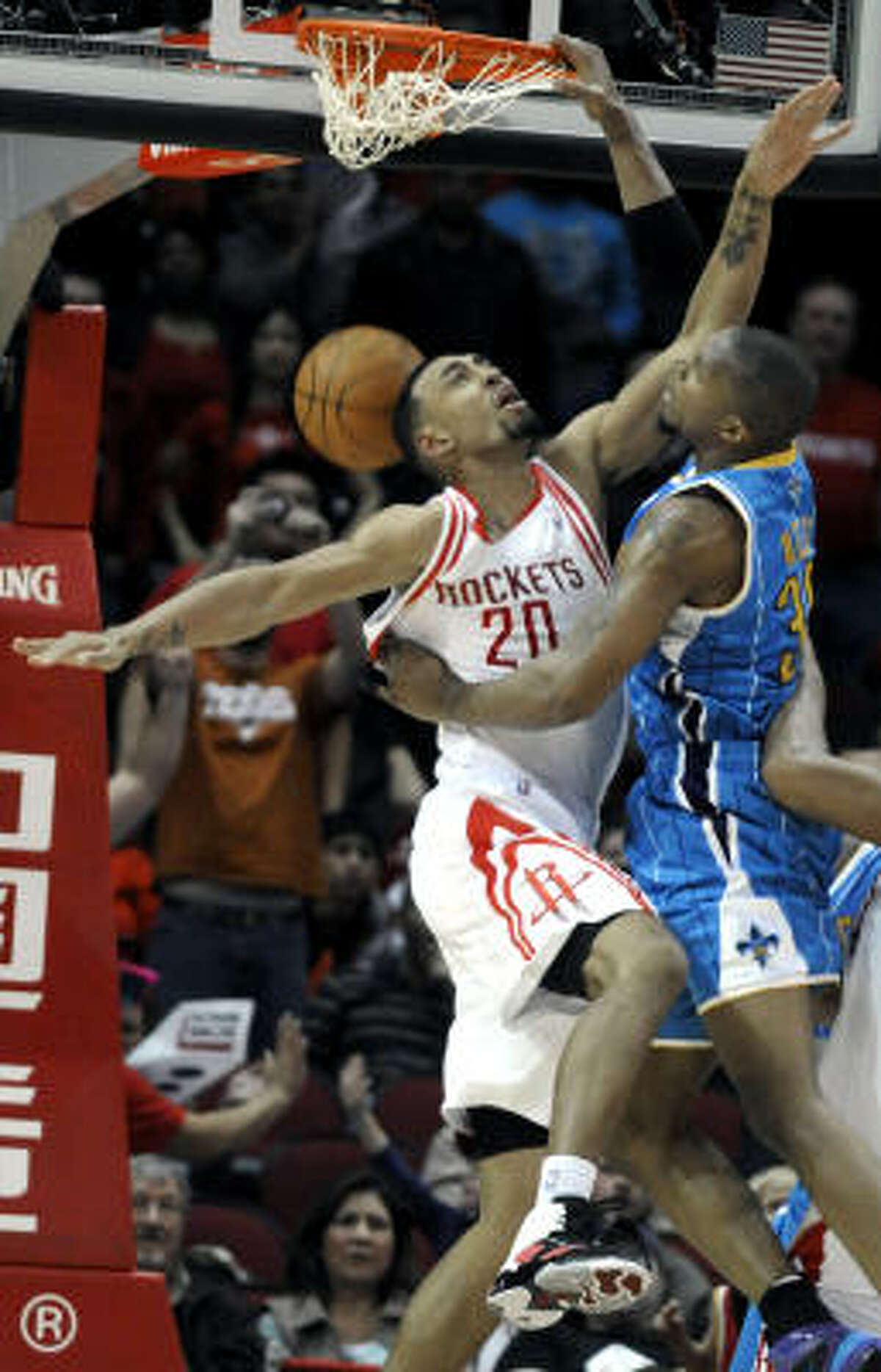 Hornets forward David West, right, dunks the ball over Rockets forward Jared Jeffries in the second half. West scored a game-high 29 points.
