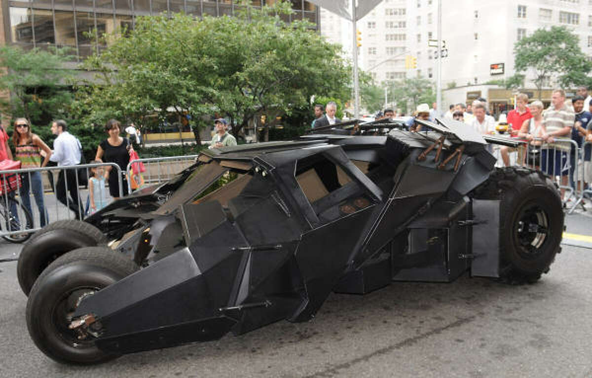 Probably the most famous superhero ride is the Batmobile. Here's the Dark Knight version, which isn't really called the