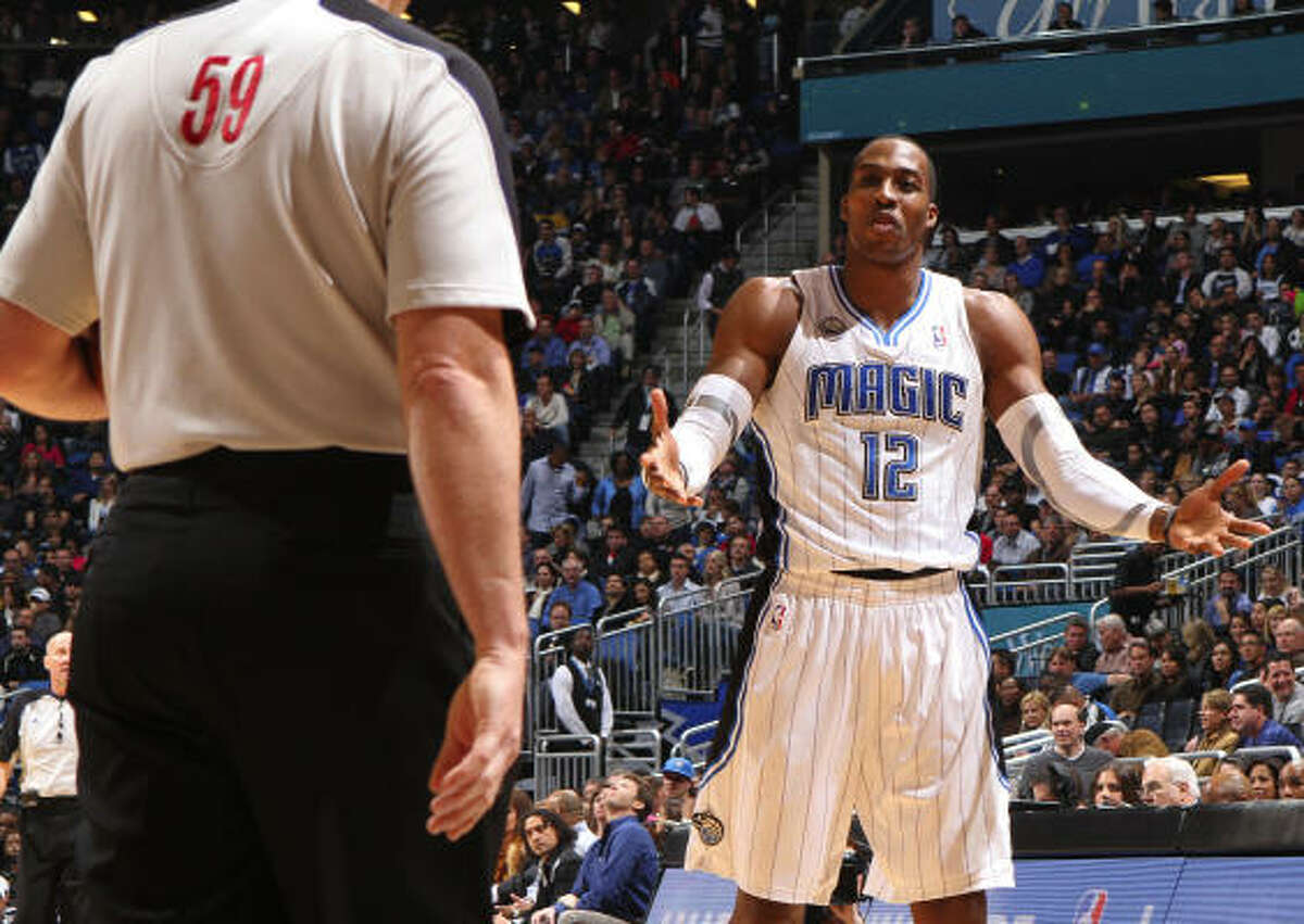 Magic center Dwight Howard looks for an explanation from official Gary Zielinski after being called for his third foul in the first half.