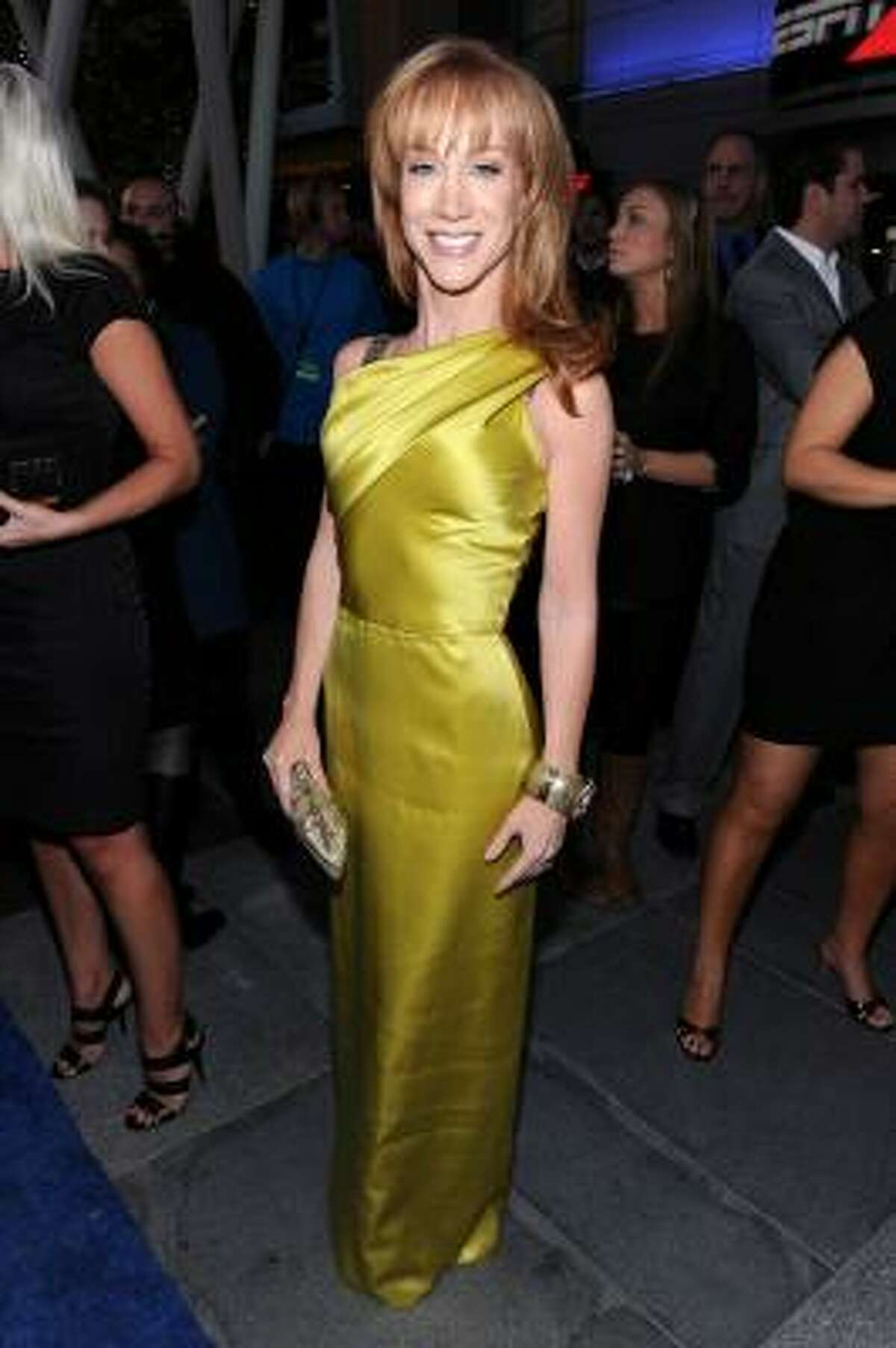 Kathy Griffin in a gold Oscar de la Renta gown. Elegant and fitting of the red carpet. Makes even Kathy Griffin look good.