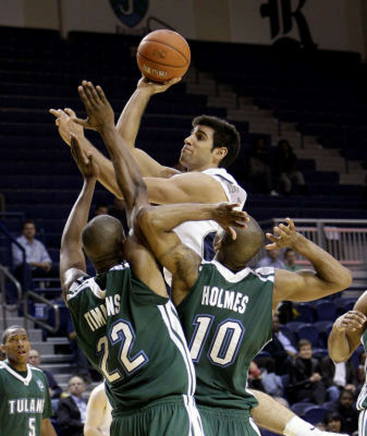 Jan. 5: Tulane 85, Rice 81 Rice's Arsalan Kazemi shoots over Tulane's Kendall Timmons (22) and Aaron Holmes during Wednesday's game at Tudor Fieldhouse. Kazemi scored career-high 28 points in a losing effort.