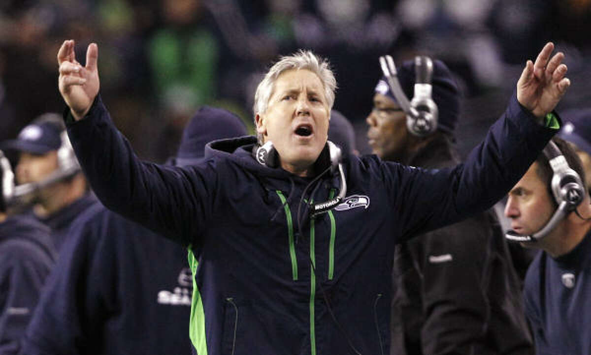 Seahawks 16, Rams 6 Seahawks coach Pete Carroll leads cheers from the sideline. Seattle wins the NFC West and make the playoffs with a 7-9 record.