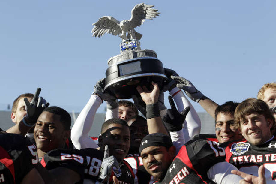 Texas Tech 45, Northwestern 38Texas Tech players hold up the trophy winning the TicketCity Bowl and finishing their season with a record of 8-5. Photo: Sharon Ellman, AP