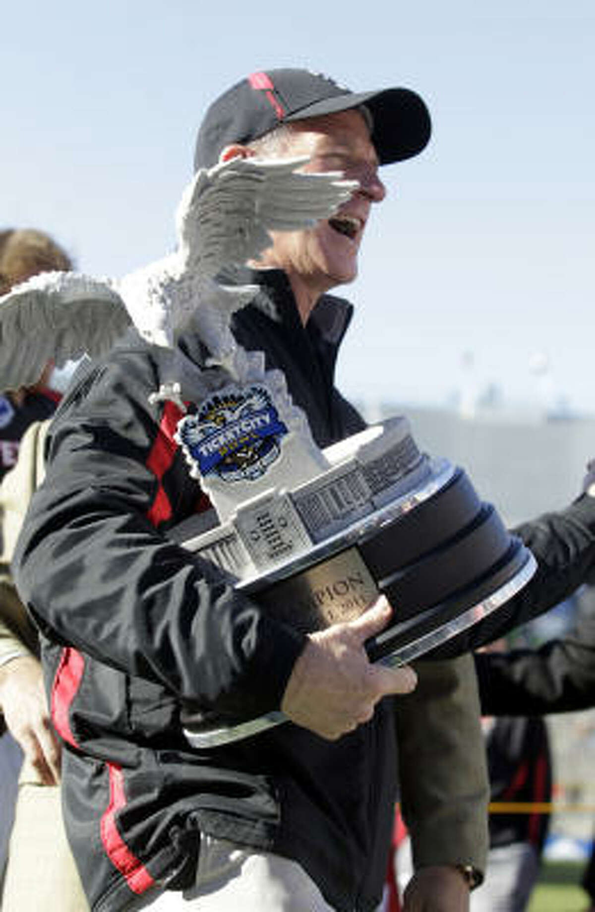 Texas Tech head coach Tommy Tuberville holds the trophy after winning the inaugural TicketCity Bowl.