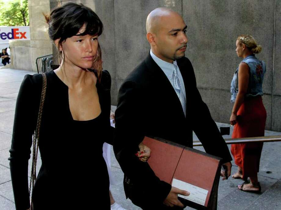 "FILE - In this July 14, 2011 file photo, actress Paz de la Huerta walks with her attorney Jamel Oeser-Sweat into the Manhattan Criminal Courts building in New York. The ""Boardwalk Empire"" actress admitted Thursday, July 14, 2011 that she harassed a reality TV figure in a confrontation that authorities said was laced with ill will about their respective claims to fame. (AP Photo/Craig Ruttle, file) Photo: Craig Ruttle"