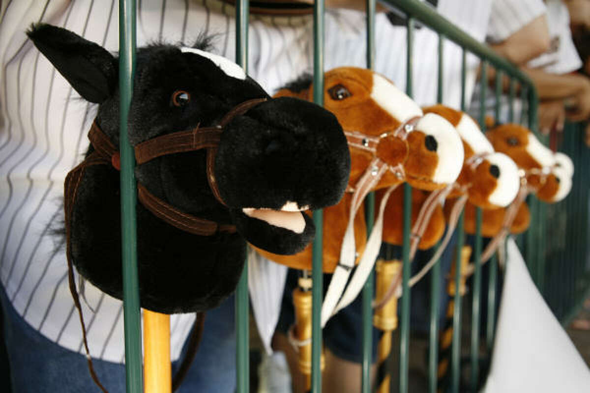 The Los Caballitos steeds wait in their stalls Wednesday during the Astros-Giants game at Minute Maid Park.
