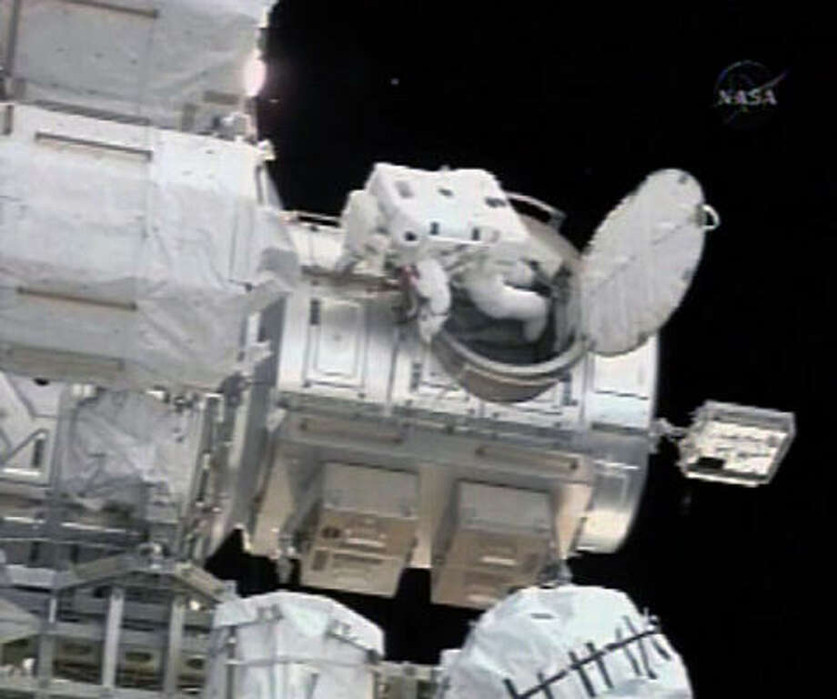 In this image from NASA TV, Canadian astronaut Dave Williams emerges from the air lock at the start of a spacewalk on the international space station today. Photo: NASA/Associated Press