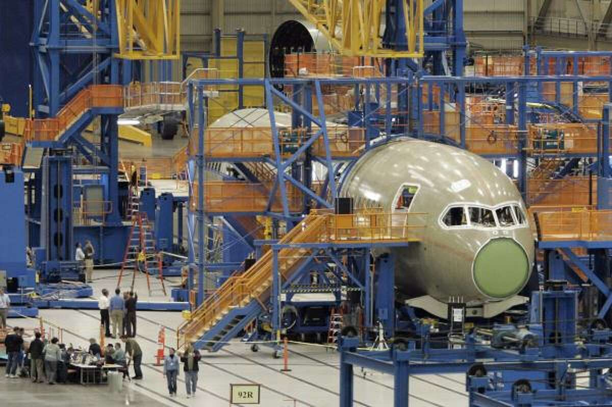 Boeing's first 787 Dreamliner takes shape in May in the company's Everett, Wash., assembly plant. The first 787 test flight has been put off for three months.