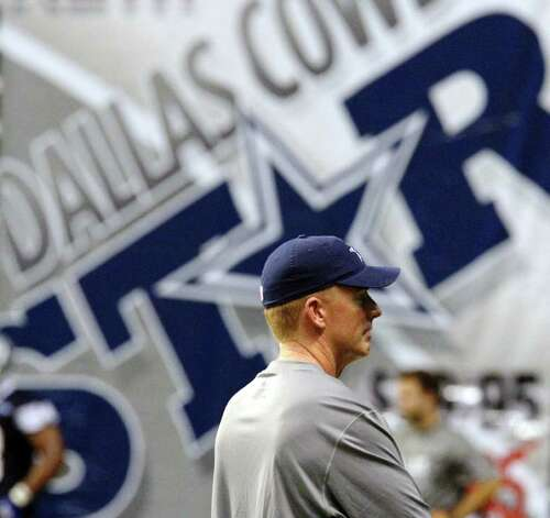 Head coach Jason Garrett oversees practice during the afternoon session of the Dallas Cowboys training camp at the Alamodome on Thursday, July 28, 2011. Kin Man Hui/kmhui@express-news.net Photo: KIN MAN HUI, : / SAN ANTONIO EXPRESS-NEWS