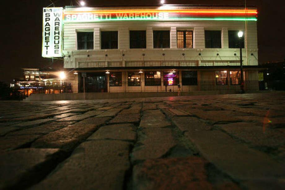 """Beef n Bun at Fuqua and Hiram Clark. Spaghetti Warehouse on Commerce (pictured) is celebrating its 40th year."" - Joe Morin Photo: Sharón Steinmann, Chronicle"