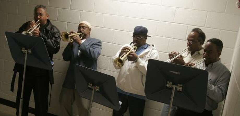 Past members of the Kashmere Stage Band prepare Wednesday for the approaching concert. Photo: BILL OLIVE, FOR THE CHRONICLE