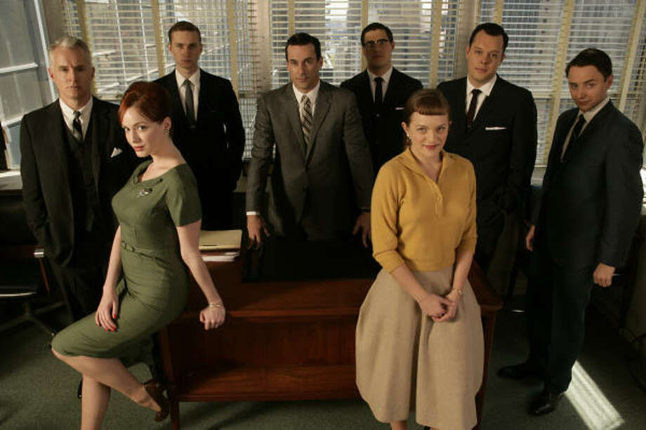 Christina Hendricks, left, plays Joan Holloway on the AMC series Mad Men. She mentors the new ``girls'' in the ways of work and men. Photo: AMC