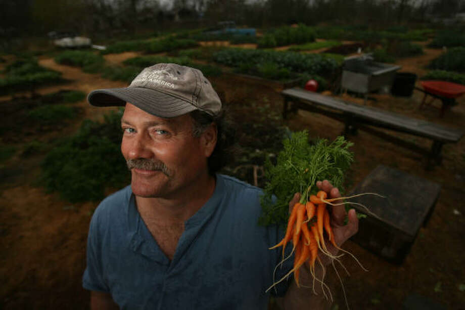 Joe Icet of Last Organic Outpost has grown organic veggies in the inner city since 1999. Photo: Mayra Beltran, Chronicle