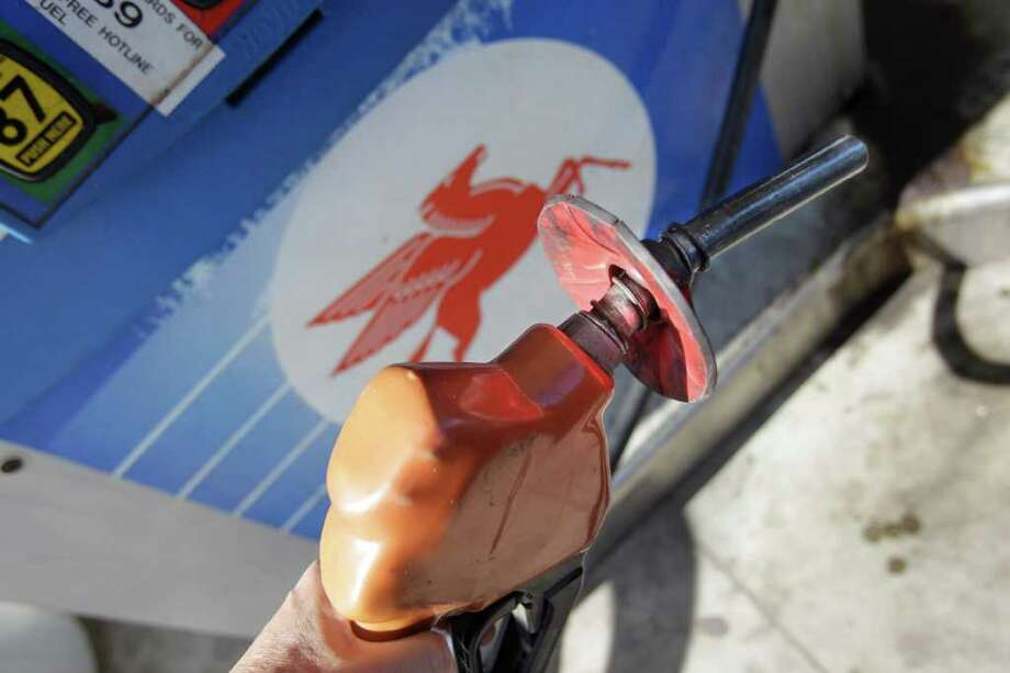 In this photo taken Wednesday, July 27, 2011, Pegasus, the winged red horse icon of Exxon-Mobil, is seen on a gas pump in Ferndale, Mich. Exxon Mobil Corp. said Thursday, July 28, that higher oil prices and improved refining margins boosted its second-quarter profits 41 percent.(AP Photo/Carlos Osorio) Photo: Carlos Osorio