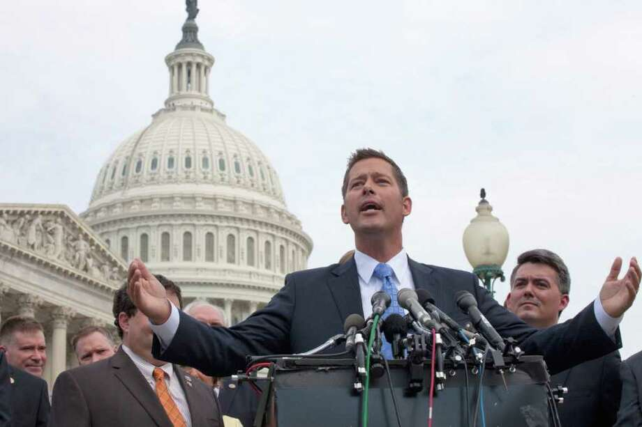 Rep. Sean Duffy, R-Ill., gestures during a news conference on Capitol Hill in Washington, Thursday, July 28, 2011, where House Republican freshmen announced they'll vote yes later Thursday on the GOP plan to raise the debt limit. (AP Photo/Harry Hamburg) Photo: Harry Hamburg