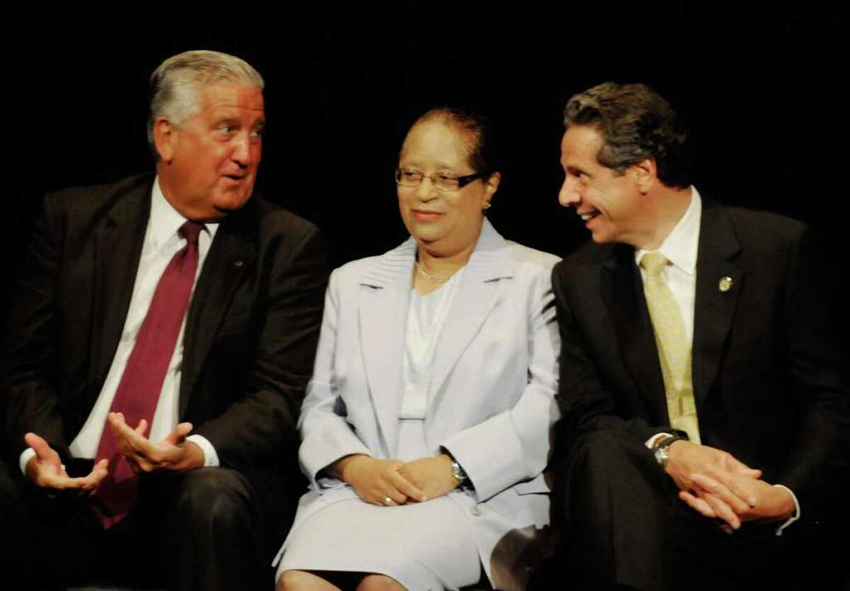 Albany Mayor Jerry Jennings, left, RPI president Shirley Jackson and Gov. Andrew Cuomo laugh at a joke by Lt. Gov. Robert Duffy as Duffy outlines the Cuomo administrations regional economic development council at SCCC in Schenectady, NY Thursday July 28,2011.( Michael P. Farrell/Times Union)