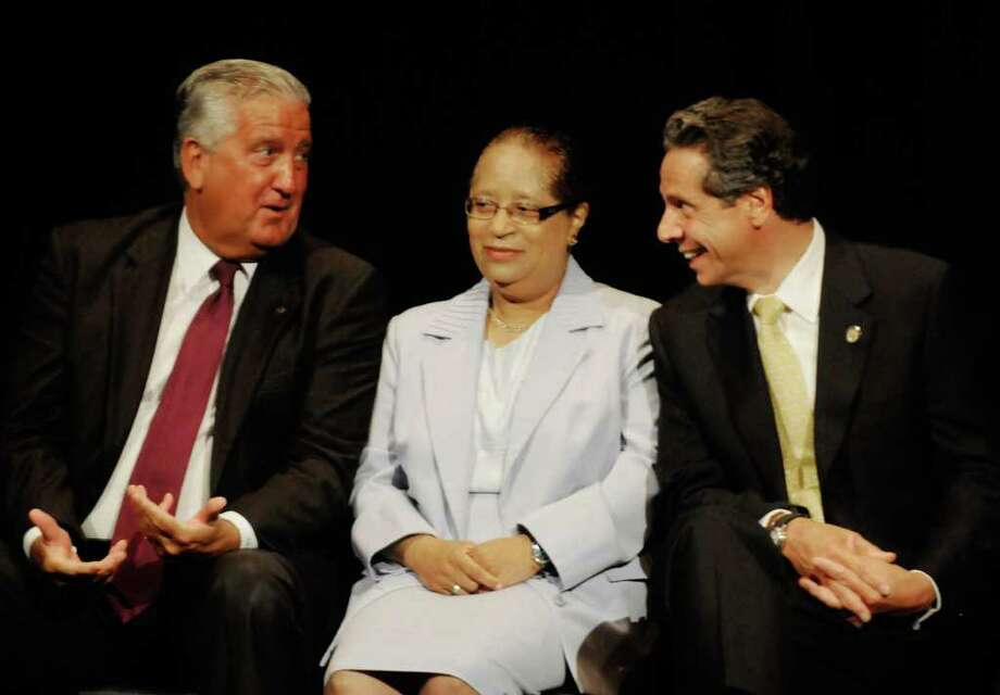 Albany Mayor Jerry Jennings, left, RPI president Shirley Jackson and Gov. Andrew Cuomo laugh at a joke by Lt. Gov. Robert Duffy as Duffy outlines the Cuomo administrations regional economic development council at SCCC in Schenectady, NY Thursday July 28,2011.( Michael P. Farrell/Times Union) Photo: Michael P. Farrell