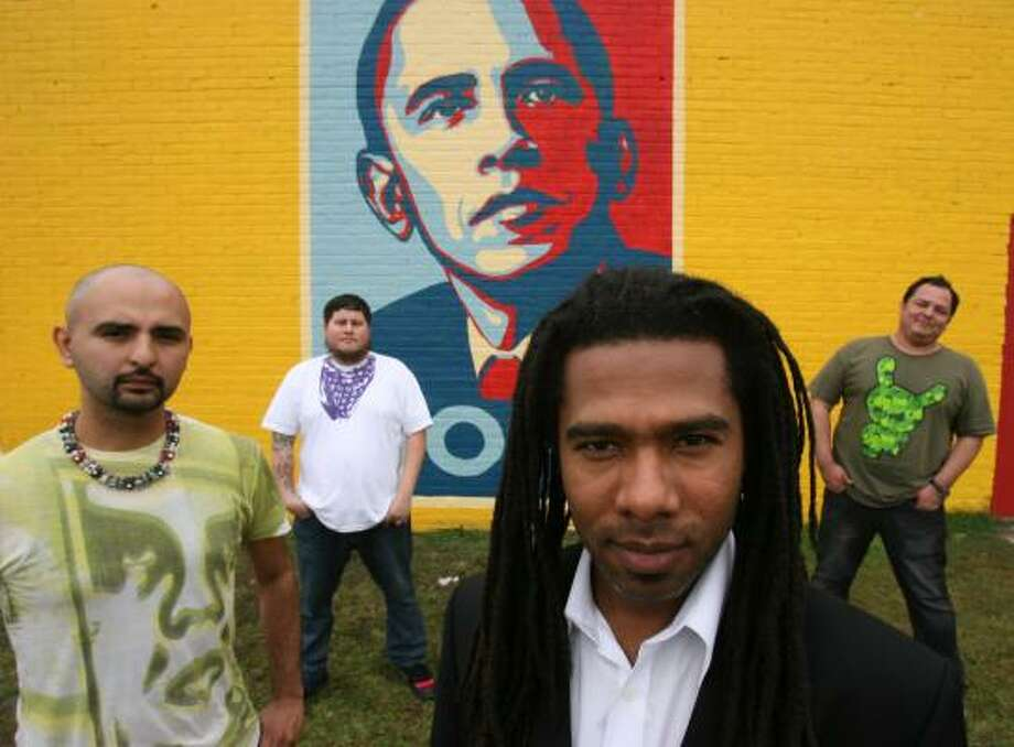 GONZO247, from left, Christian Azul, Reginald Adams and Adrian de la Cerda (Mr. Bristle) painted the Obama mural. Photo: SHARÓN STEINMANN, CHRONICLE