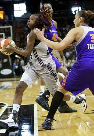 The Silver Stars' Danielle Robinson breaks through the Phoenix Mercury's Kara Braxton and Diana Taurasi to score on Thursday, July 28, 2011, at the AT&T Center. Robinson had 11 points. Photo: Sally Finneran/sfinneran@express-news.net / © SAN ANTONIO EXPRESS-NEWS