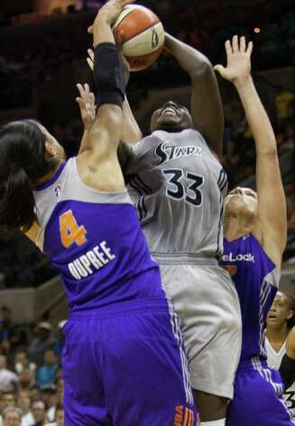 The Mercury's Candice Dupree blocks against Silver Stars forward Sophia Young on Thursday, July 28, 2011, at the AT&T Center. Young had nine points. Photo: Sally Finneran/sfinneran@express-news.net / © SAN ANTONIO EXPRESS-NEWS