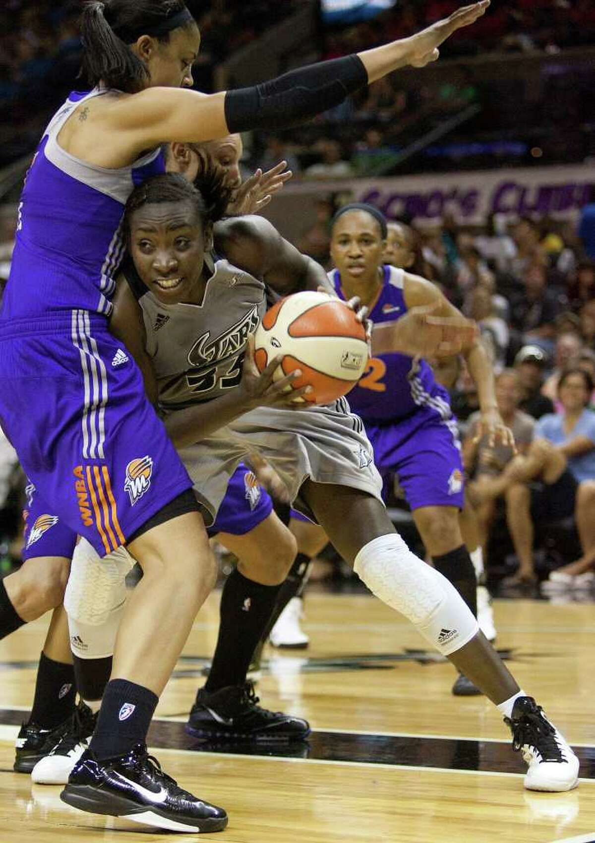 Silver Stars forward Sophia Young searches for room against the Mercury's Candice Dupree on Thursday, July 28, 2011, at the AT&T Center. Young had nine points.