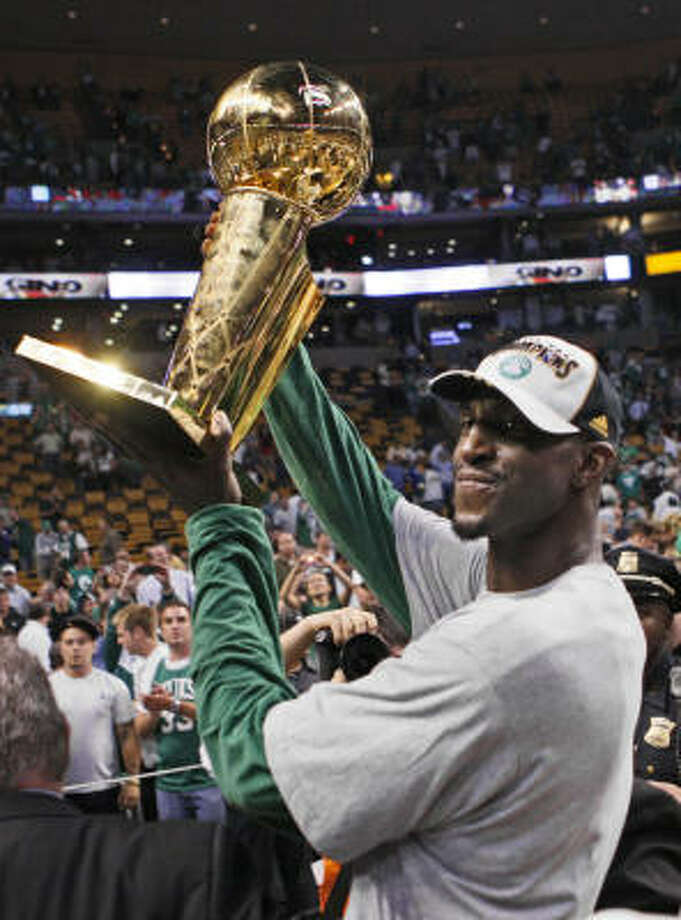 Boston Celtics' Kevin Garnett holds the NBA Championship trophy after the Celtics' 131-92 win over the Los Angeles Lakers in Game 6 of the NBA Finals on Tuesday in Boston. Photo: Elise Amendola, AP