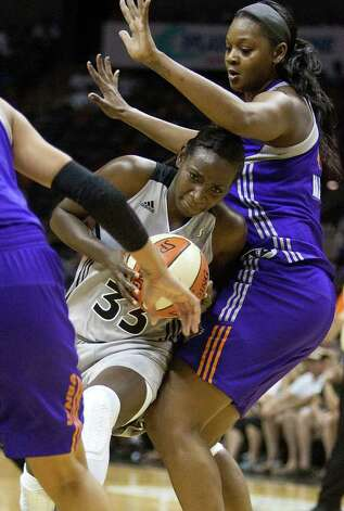 Silver Stars forward Sophia Young pushes past the Mercury's Kara Braxton on Thursday, July 28, 2011, at the AT&T Center.  Young had nine points. Photo: Sally Finneran/sfinneran@express-news.net / © SAN ANTONIO EXPRESS-NEWS