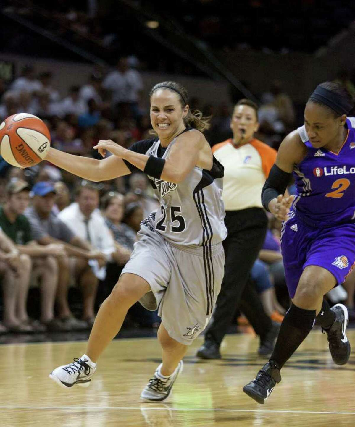 Silver Stars guard Becky Hammon drives the lane against Phoenix Mercury guard Temeka Johnson on Thursday, July 28, 2011 at the AT&T Center. Hammon had 33 points in the Silver Stars' 102-91 victory.