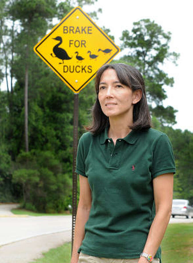 Jill Tagudin stands by the duck crossing sign at the corner of Alden Bridge and Taylor Point. July 2008 Photo: David Hopper, For The Chronicle