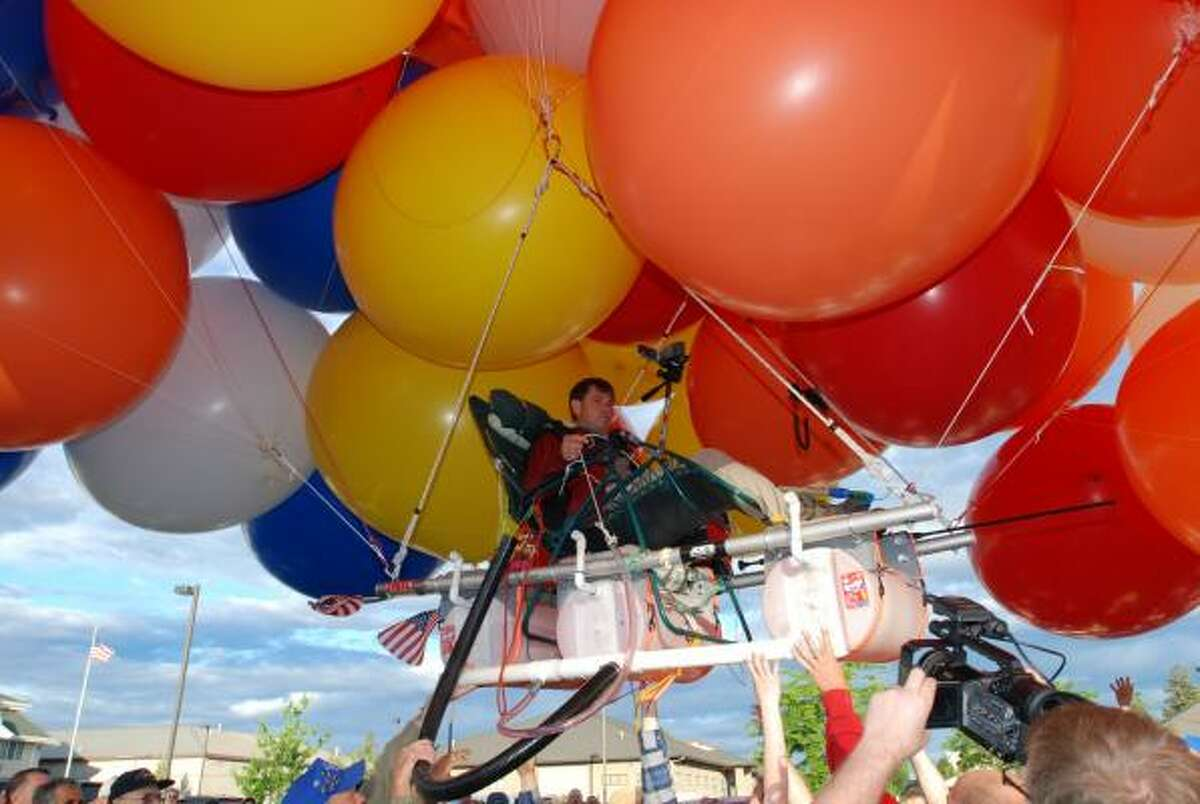 Couch, 48, is making his third balloon flight and hopes to go more than 200 miles to Idaho before running out of daylight or helium. He is equipped with a BB gun and a blowgun for popping balloons if he gets too high and three 15-gallon barrels of cherry Kool-Aid for ballast to release if he gets too low.