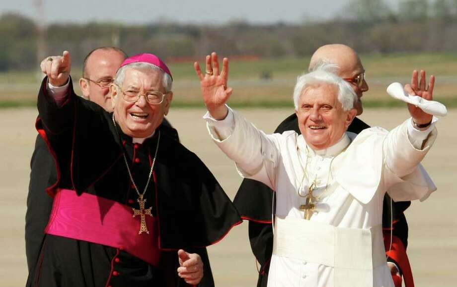 FILE -- In this file photo taken at Andrews Air force Base, Md., in this file photo dated April 15, 2008 Pope Benedict XVI, right, is seen with Papal Nuncio Pietro Sambi. The Vatican says its ambassador to the United States Archbishop Pietro Sambi has died in a U.S. hospital after suffering complications after recent lung surgery. The 73-year-old Sambi died Wednesday in Johns Hopkins Hospital in Baltimore where he had been placed on assisted ventilation. He had undergone surgery two weeks ago. The Italian prelate had served as papal representative in Washington since 2006, one of Pope Benedict XVI's first major appointees. (AP Photo/Gerald Herbert, File) Photo: Gerald Herbert / AP